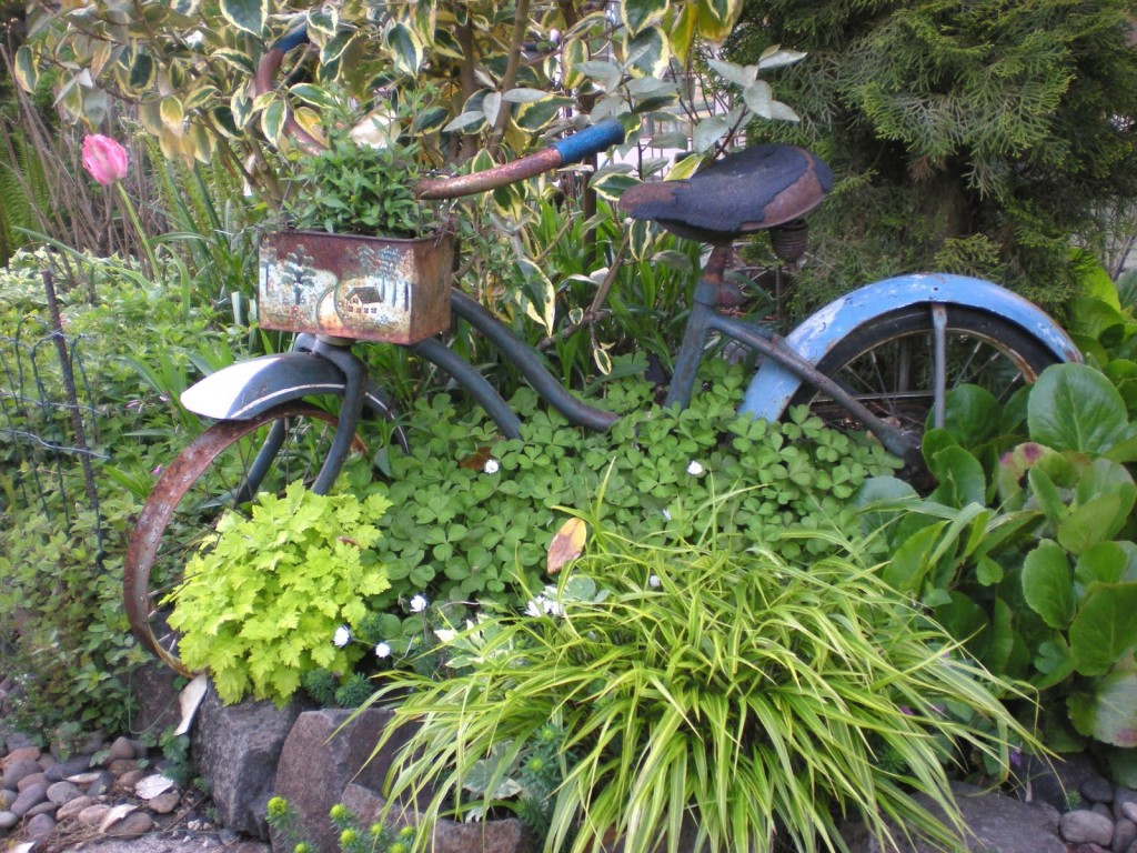 An old bike becomes a planter, photo from Gardening with Grace.