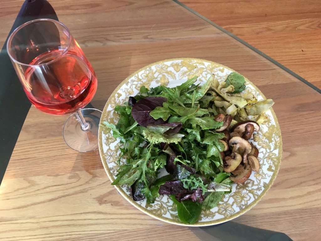 Mixed baby greens with balsamic dressing, sauted mushrooms, and oven roasted artichoke hearts--with a light rosé.