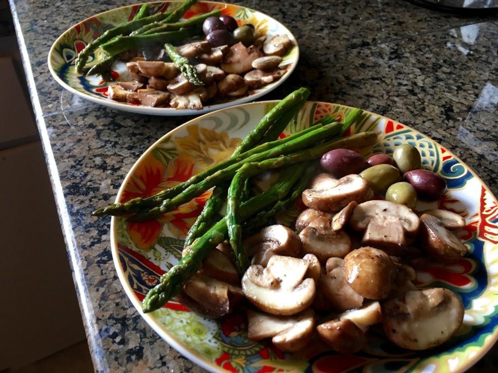 Happy hour appetizer, sautéd mushrooms, asparagus, and olive medley.