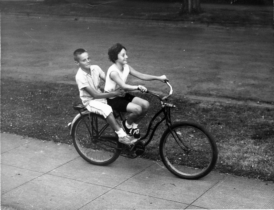 My brother and me sharing a bike.