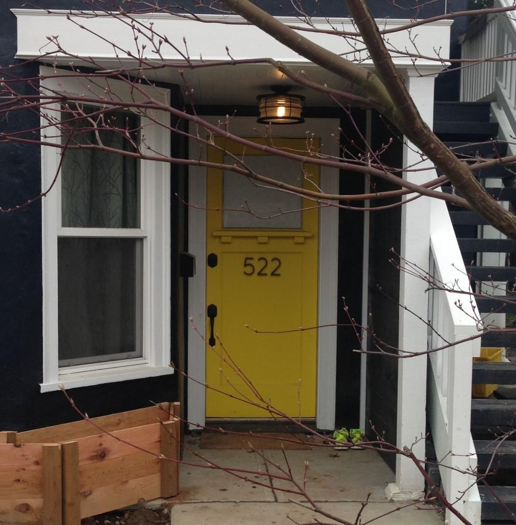 black house yellow door head on