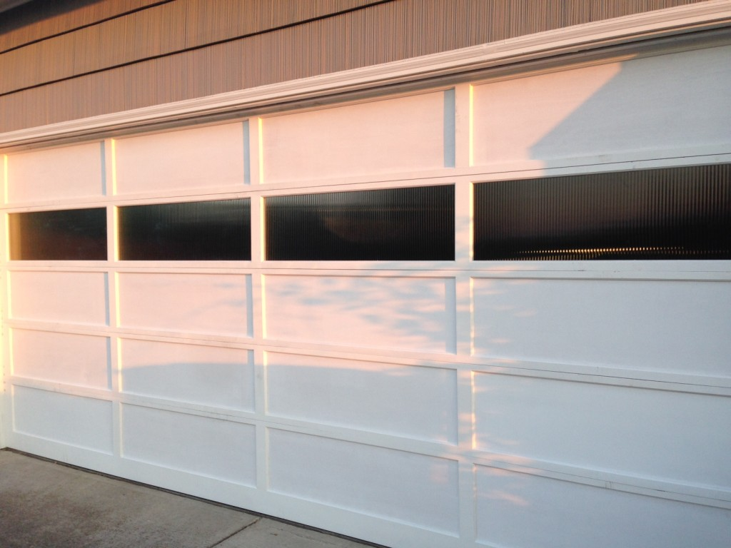 New garage door with reeded glass to match front entrance.