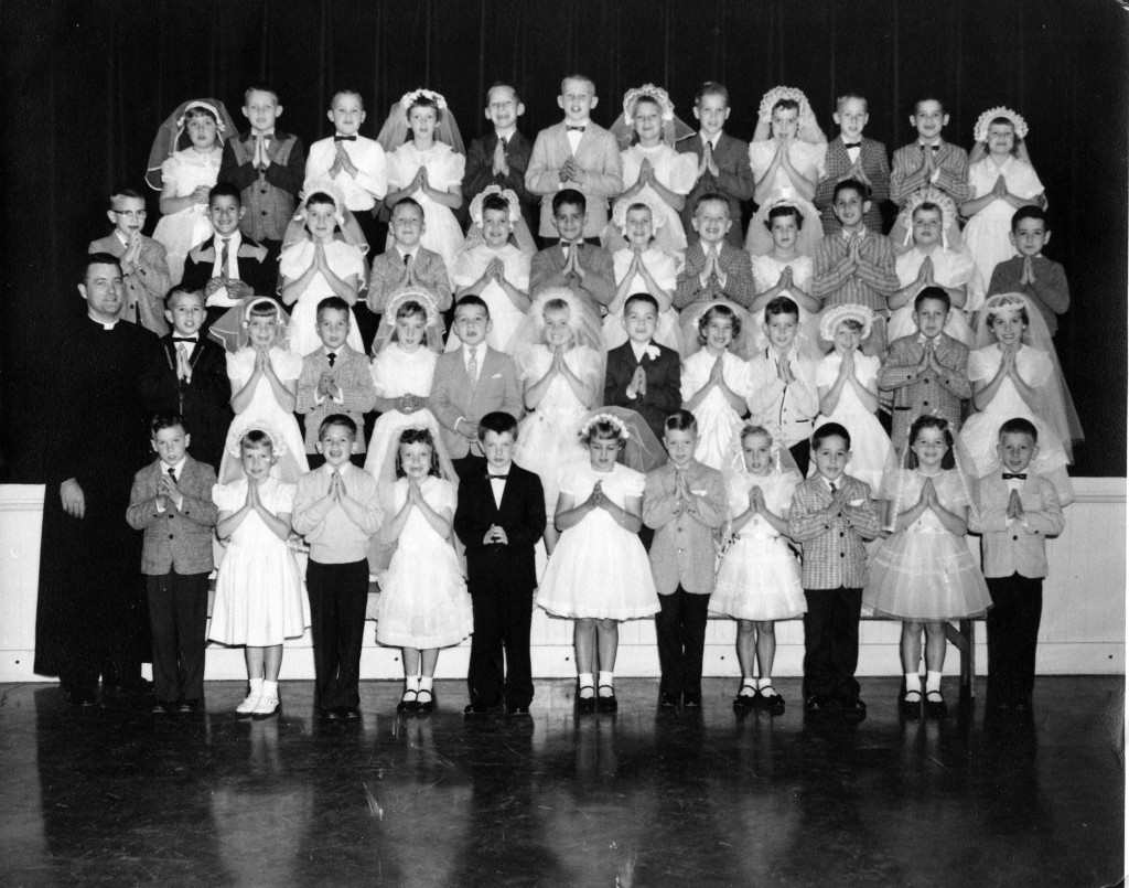 I'm third from the left, second row down, trying hard not to be sinful.