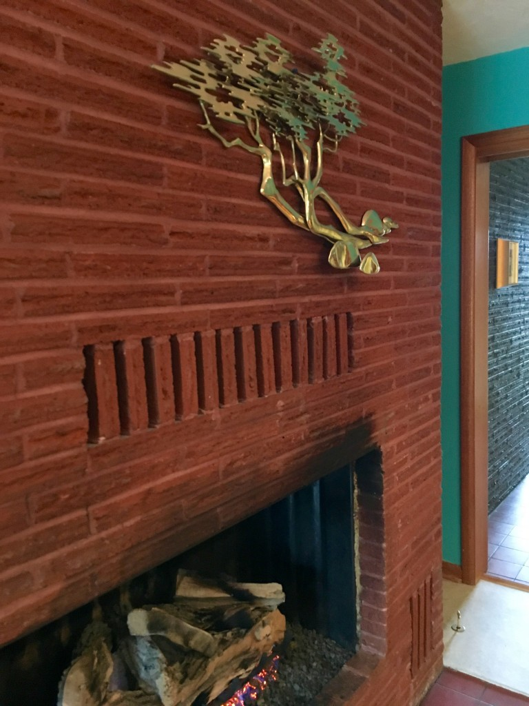 Brass art is perfect over the family room fireplace. Can't believe my luck.
