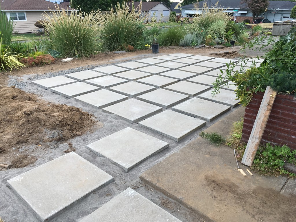 Patio and path in progress. This settles the grass question: none in front.